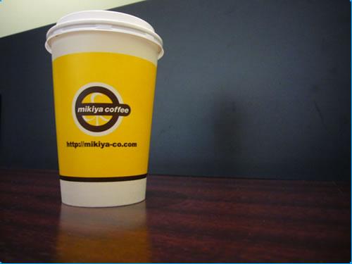 マスクされる写真でコーヒーのカップ